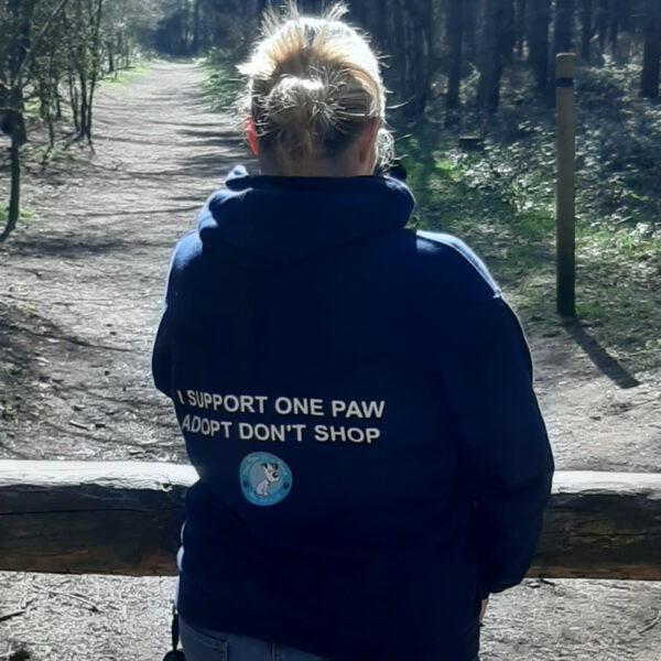 Back of One Paw Hoodie showing logo and text