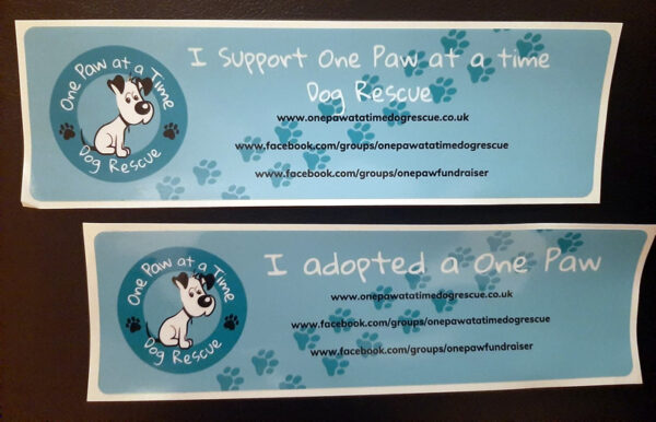 Car stickers showing support for One Paw at a Time Dog Rescue